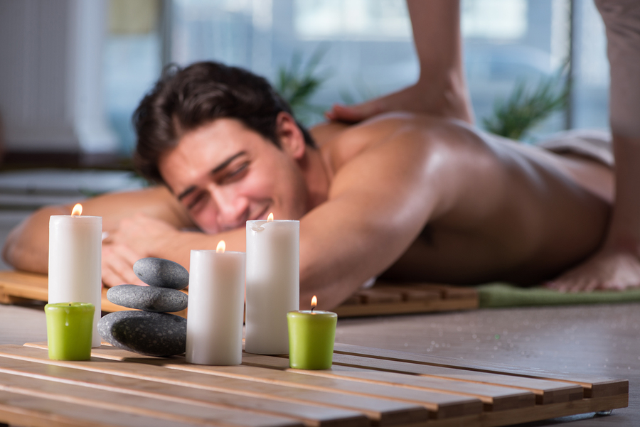 Young handsome man during spa procedure in New York Spa massage , Juvenex Spa