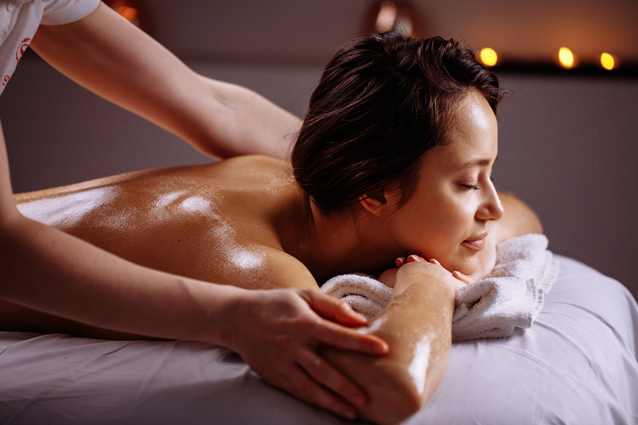 Body care. Spa body massage treatment in New York NYC, Woman having massage in the spa salon