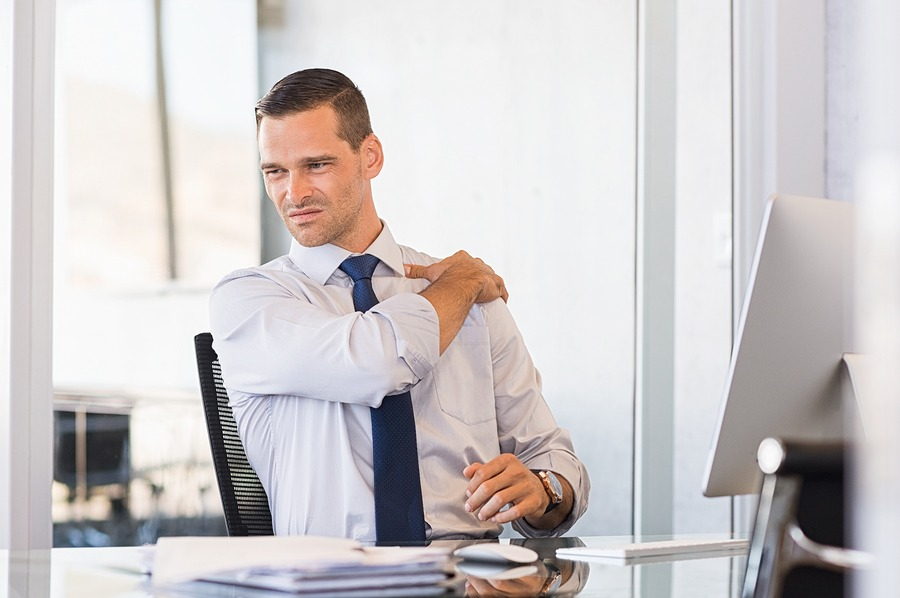 young businessman with shoulder pain