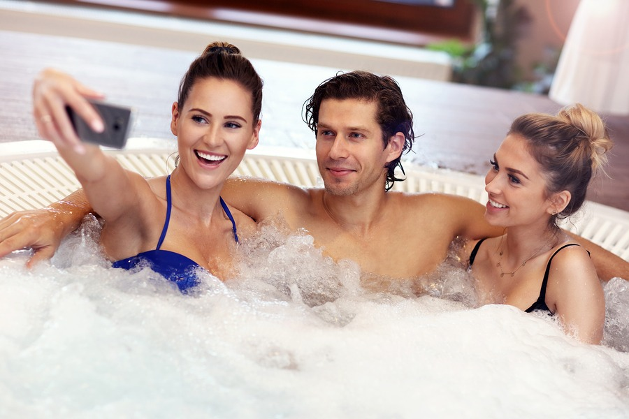 a man and two woman in a jacuzzi