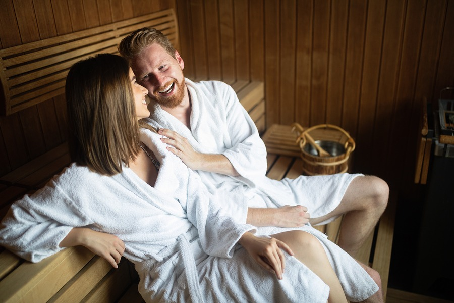 Young happy couple relaxing at spa