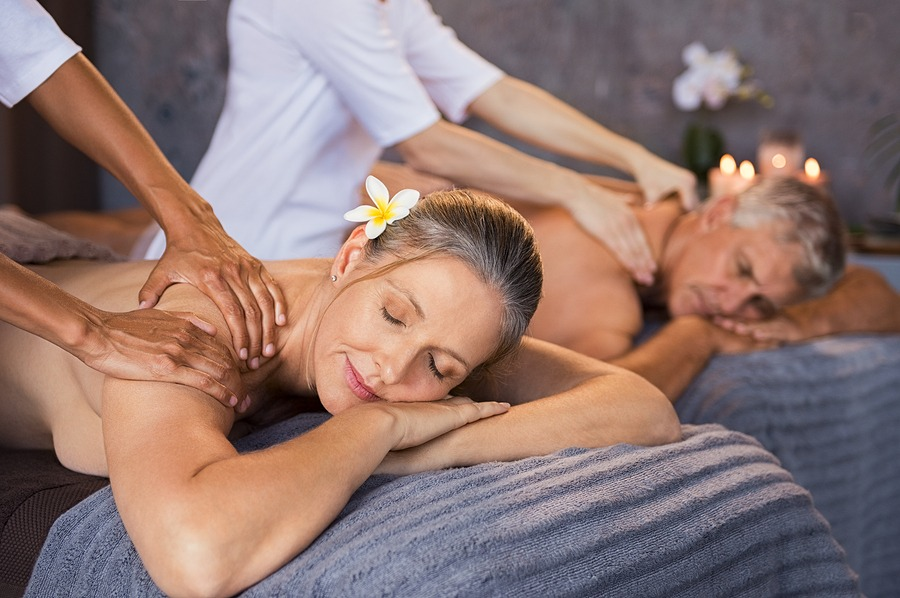 Senior couple in spa salon getting massage. Relaxed senior coupl