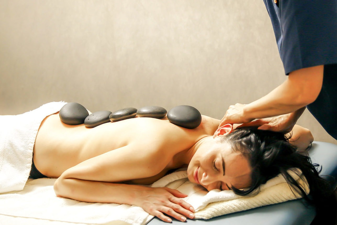 Woman getting hot stone massage