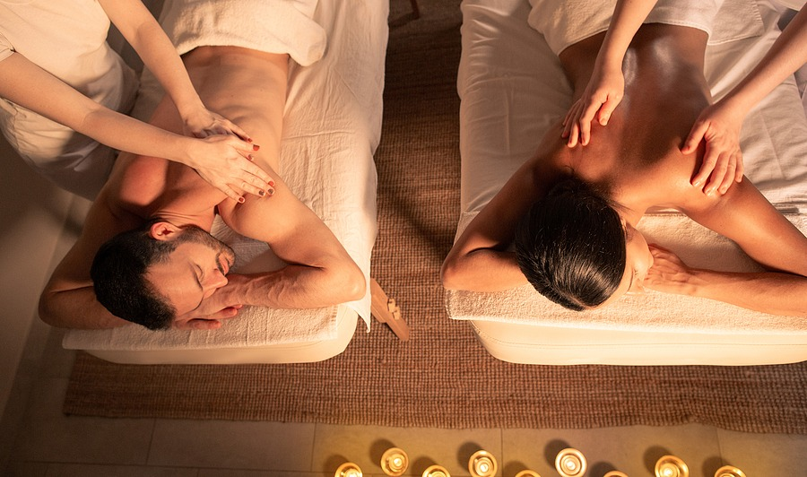 Couple massage with aroma oil, top view. massage spa near me now open, Juvenex Spa in New York, Korean Body Scrub - Relaxing Spa Massage, We are Open NOW!