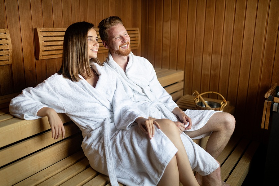 Happy couple having a steam bath in a sauna, The ultimate escape for couples for a special and memorable night. Perfect for couples celebrating a special occasion in New York NYC