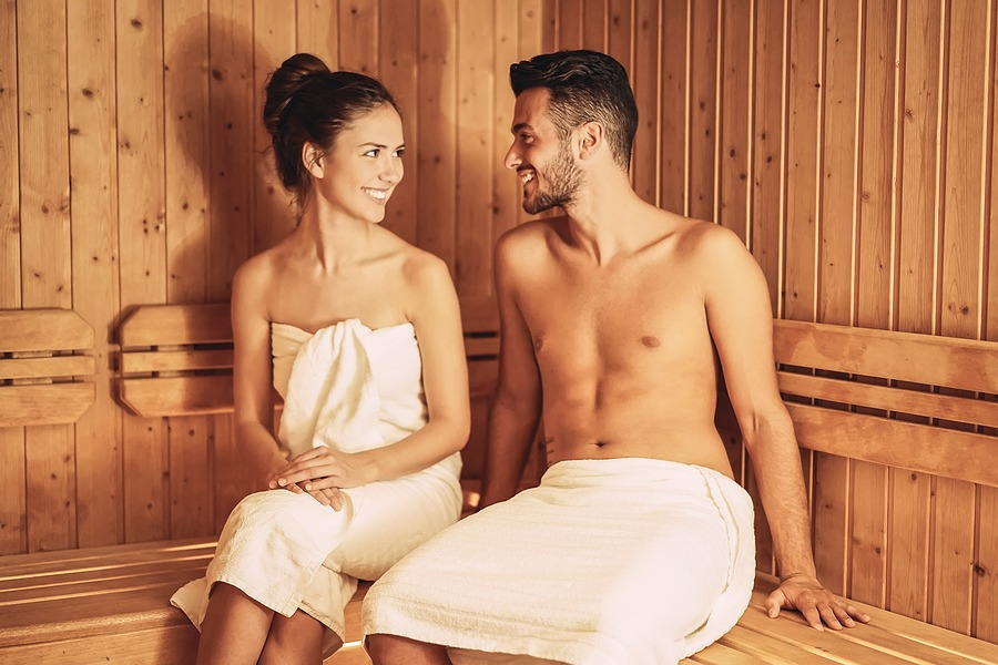 Happy couple relaxing inside sauna spa resort hotel - Romantic young lovers having relaxing day in luxury steam bath salon The ultimate escape for couples for a special and memorable night. Perfect for couples celebrating a special occasion in New York NYC
