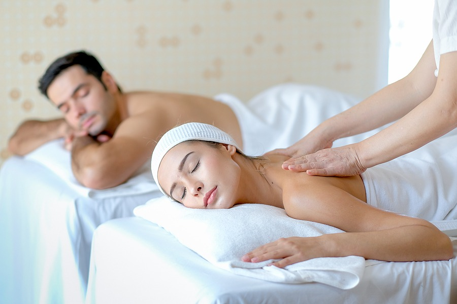 Young woman enjoy massage with her couple man who lie beside in spa room, massage spa near me now open, Juvenex Spa in New York, Korean Body Scrub - Relaxing Spa Massage, We are Open NOW!