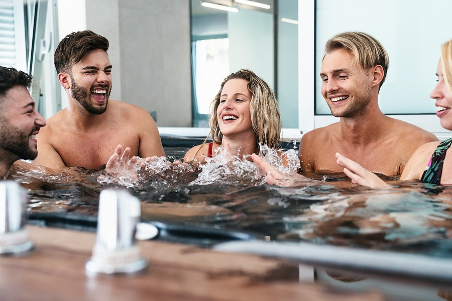 Happy friends enjoying vacations in jacuzzi luxury spa massage - Young people having fun together in hot tub - New Year's Vacation Deals Top Getaway valentine gift card for wife valentines ideas for her in New York City