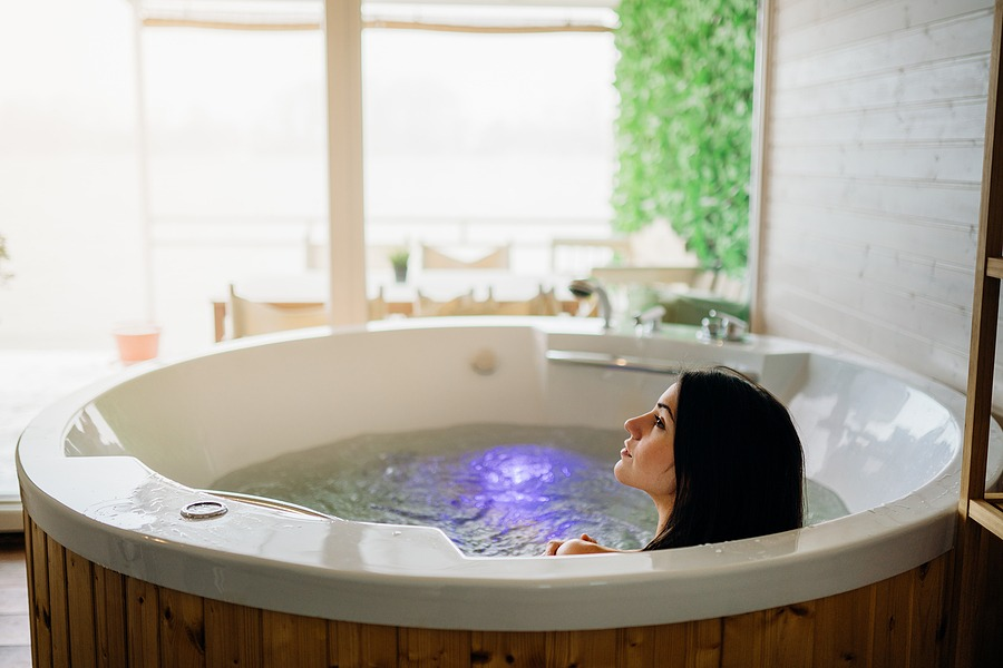Woman having a spa day moment in indoor Spa .Relaxing at spa in the hot tub bath. New Year Holiday getaway Gift Card New Year's day getaway Massage Spa Package for two in Manhattan NYC, New York