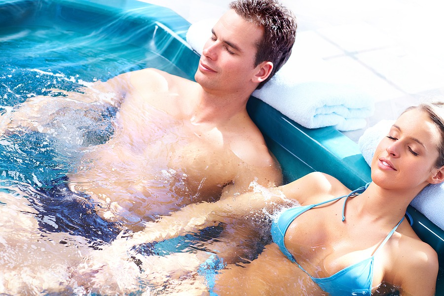Young loving couple relaxing in a comfortable . Best cities for New Year's Eve celebration with family 2021 last minute gifts unique gifts card for couples, Spa massage in New York City, Manhattan