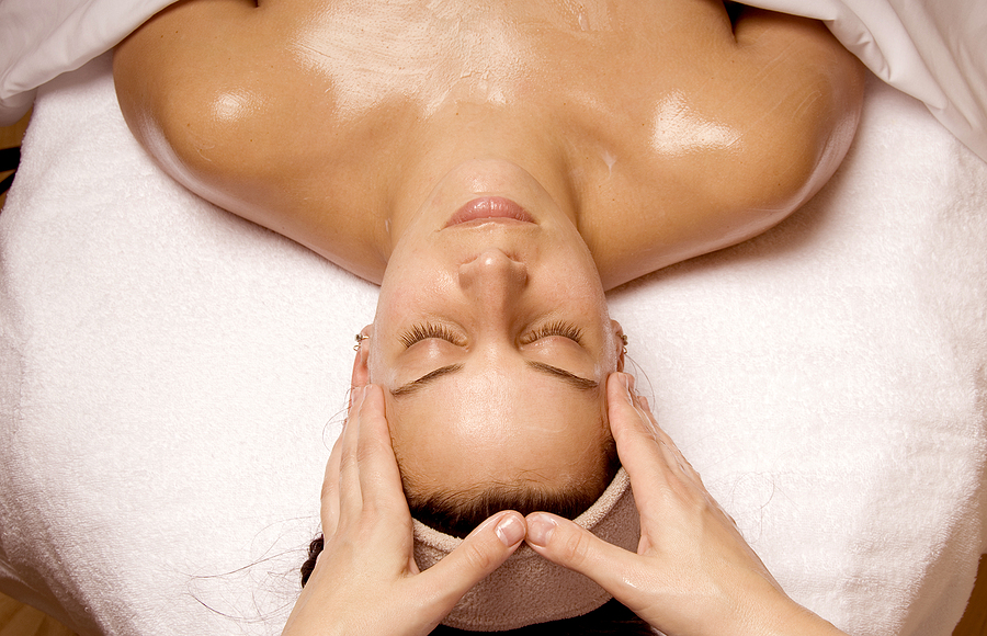 Open full resolution image of woman receiving face massage